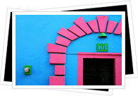 colourful pink and blue house front